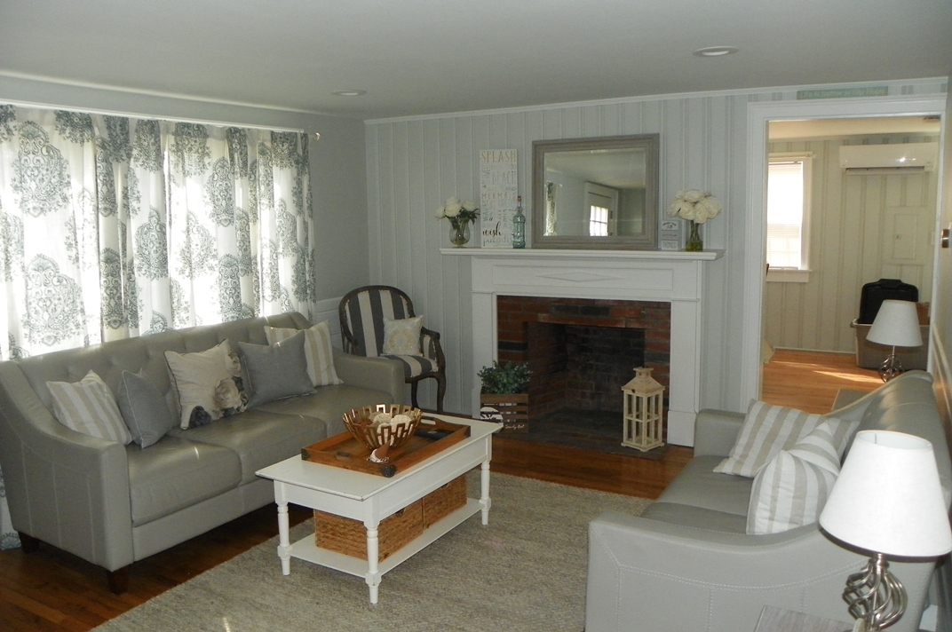 Living Room with Fireplace at 44 Shore Road, West Dennis, MA for sale by Cranberry Real Estate 508-394-1700