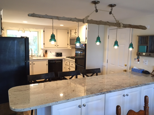 Kitchen breakfast bar with view of Swan River at 5 Barnacle Way, So. Dennis, MA 02660