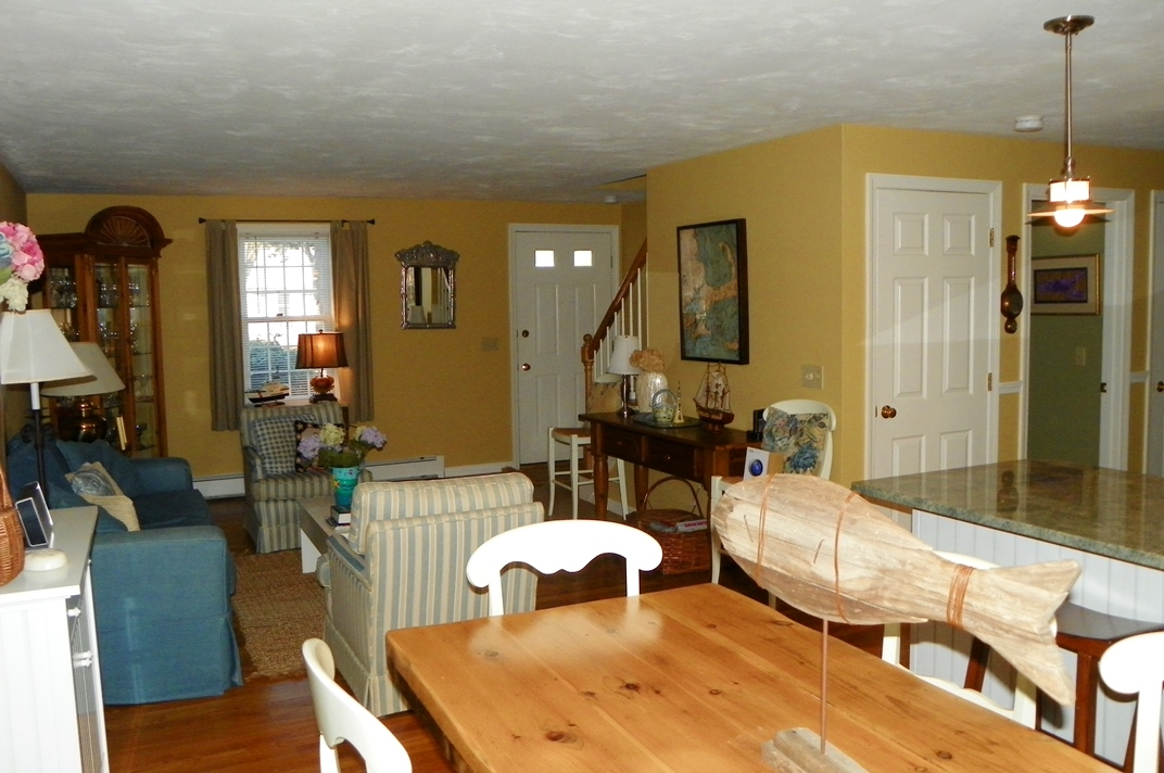 Dining and family room at 66 Kelleys Pond Road, West Dennis, MA 02670