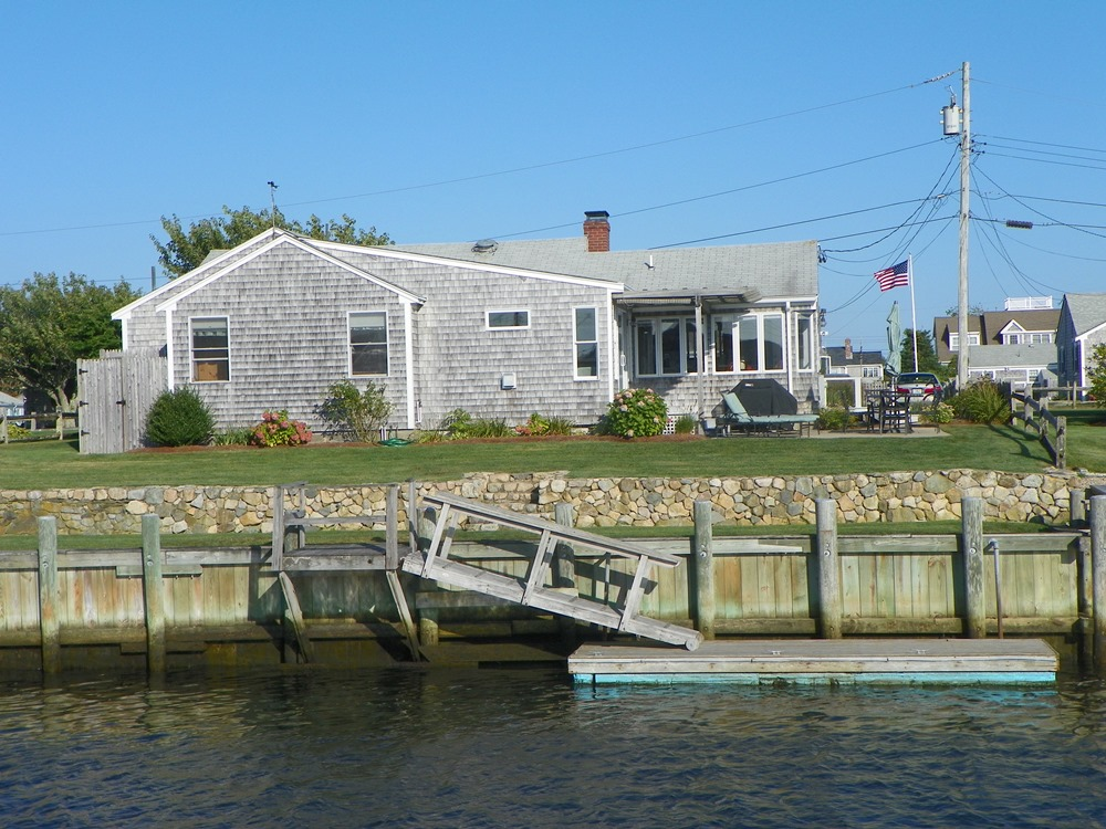 View of dock at 7 Port Way, West Dennis, MA for sale by Cranberry Real Estate 508-394-1700